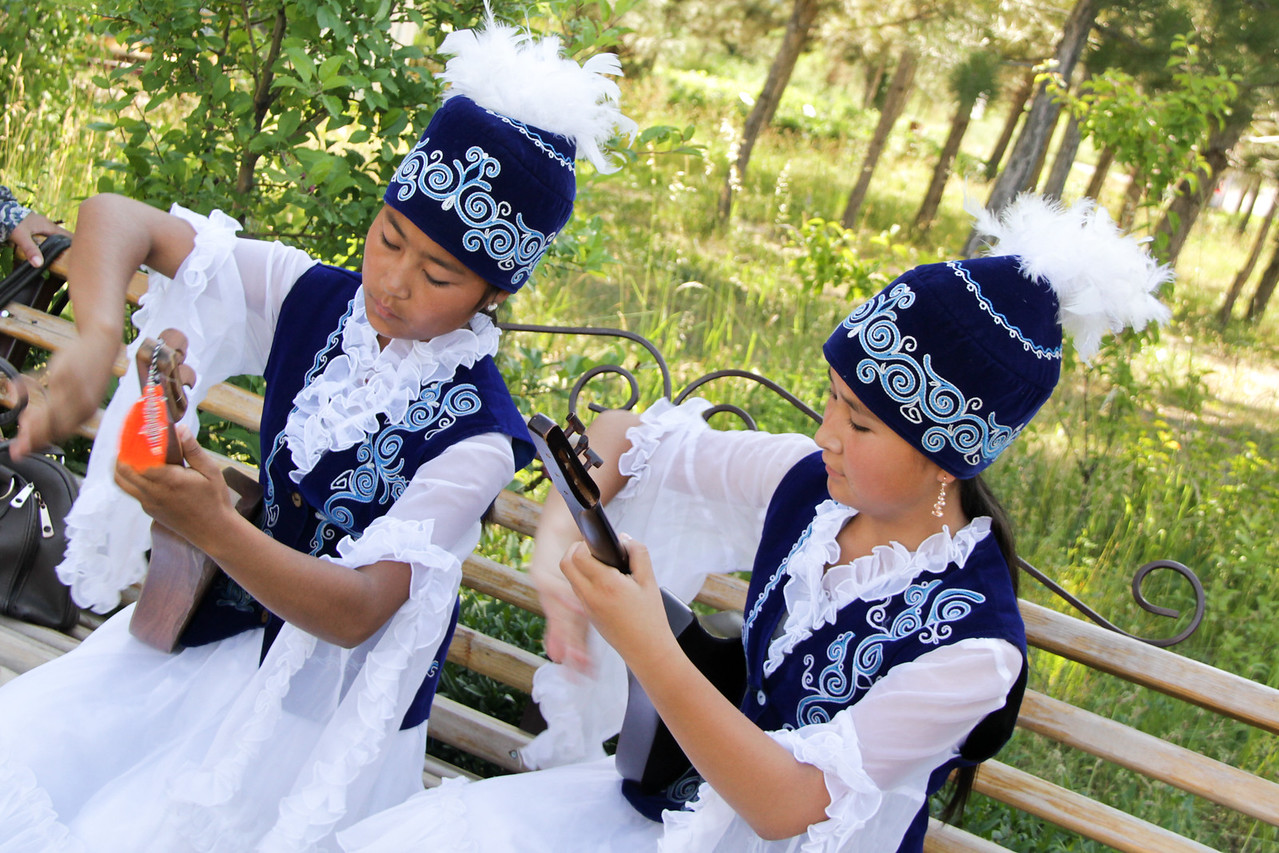 Listing to young girls playing the traditional Kyrgyz Music
